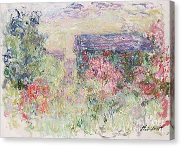 The House Through The Roses Canvas Print by Claude Monet