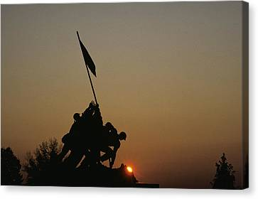 The Iwo Jima Memorial Silhouetted Canvas Print by Kenneth Garrett