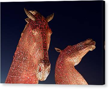 The Kelpies Illuminated Red Canvas Print by Stephen Taylor