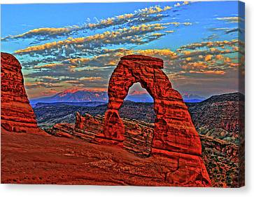 Canvas Print featuring the photograph The La Sal Mountains And Arch by Scott Mahon
