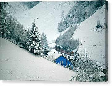Canvas Print featuring the photograph The Little Red Train - Winter In Switzerland  by Susanne Van Hulst
