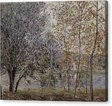 The Loing Canal In Spring Canvas Print by Alfred Sisley