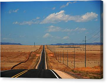 The Long Road To Santa Fe Canvas Print by Susanne Van Hulst