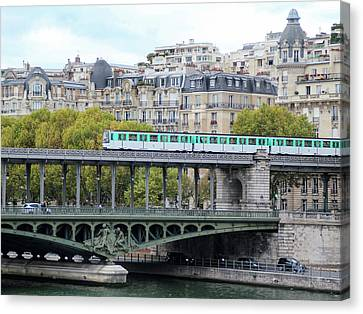 Canvas Print featuring the photograph The Metro On The Bridge by Yoel Koskas