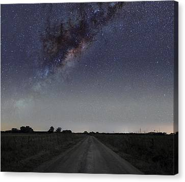 The Milky Way Galaxy Over A Rural Road Canvas Print by Luis Argerich