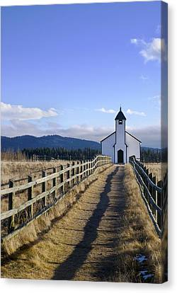 The Morley Church, Alberta, Canada Canvas Print by Philippe Widling