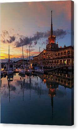 the nautical station and the yacht on the main sea channel of the Sochi seaport Canvas Print by George Westermak