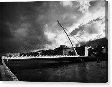 the new Samuel Beckett Bridge across the river liffey in Dublin republic of ireland under dark grey  Canvas Print by Joe Fox