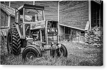 The Old Tractor By The Old Round Barn Canvas Print by Edward Fielding