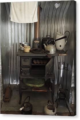 The Old Wood Stove. Canvas Print by Denise Clark