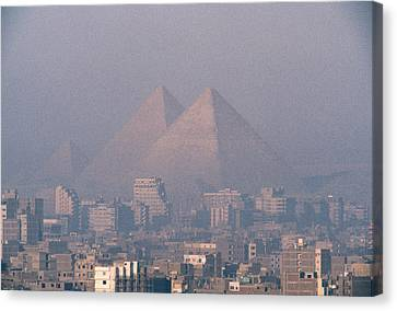 The Pyramids At Giza And Cairo Canvas Print by Martin Gray