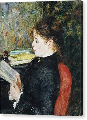 Reading A Book Canvas Print - The Reader by Pierre Auguste Renoir