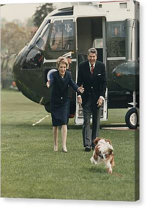 The Reagans Being Greeted By Their Dog Canvas Print by Everett