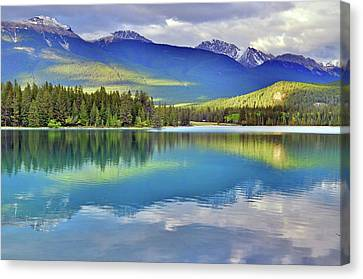 Canvas Print featuring the photograph The Rockies Reflected In Lake Annette by Tara Turner