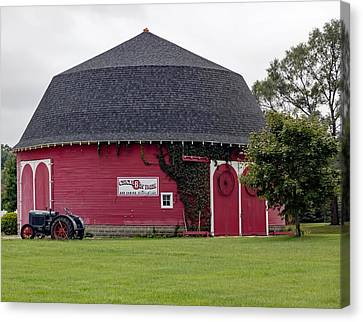 The Round Barn Canvas Print by L O C