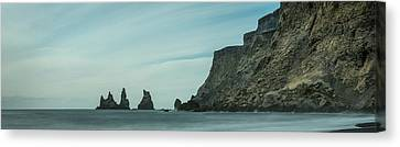 The Sea Stacks Of Vik, Iceland Canvas Print by Andy Astbury