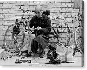 The Shoe Mender Canvas Print by Nigel Fletcher-Jones