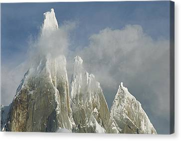 The Summit Of Cerro Torre Massif Rises Canvas Print by Jimmy Chin