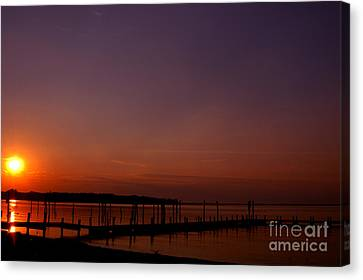 The Sun Sets Over The Water Canvas Print by Clayton Bruster
