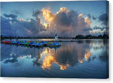 Canvas Print featuring the photograph The Sun Settles At The Shoreline by Peter Thoeny