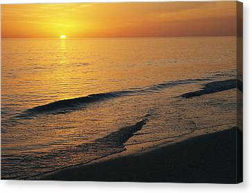 The Sun Sinks Into The Gulf Of Mexico Canvas Print by Klaus Nigge
