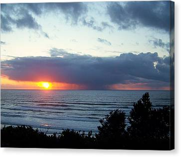 The Sunset And The Storm Canvas Print by Angi Parks