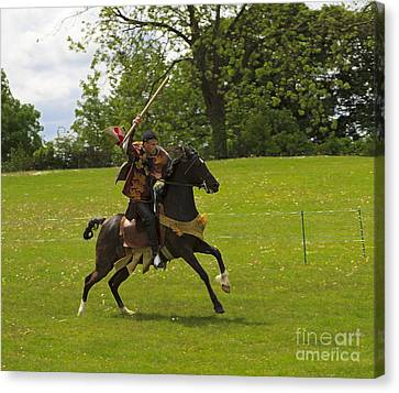 The Toss A Squire Throws A Javelin From Horseback Canvas Print by Louise Heusinkveld