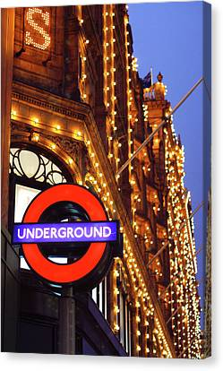 The Underground And Harrods At Night Canvas Print