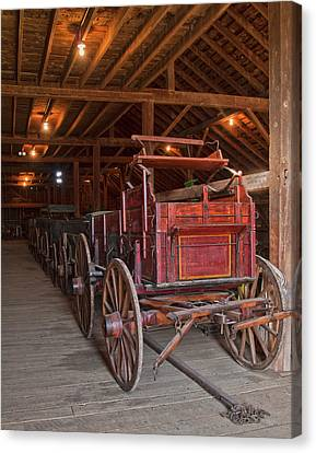 The Wagon Barn Canvas Print by Ron  McGinnis