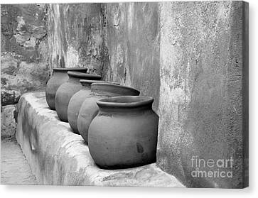 The Wall Of Pots Canvas Print by Sandra Bronstein