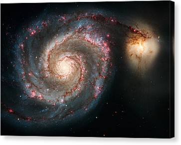 The Whirlpool Galaxy Canvas Print by Marco Oliveira