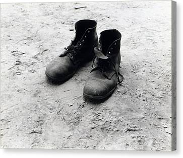 The Work Boots Of Foyd Burroughs Canvas Print by Everett
