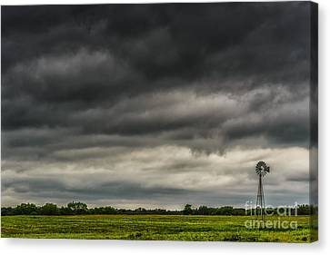 Threatening Sky Windmill Canvas Print by Thomas R Fletcher