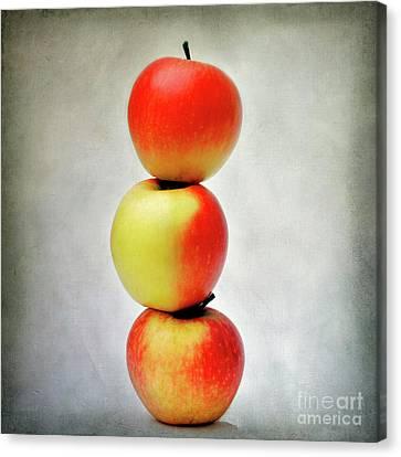 Three Apples Canvas Print by Bernard Jaubert