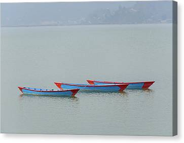 Three Blue Boats On Phewa Lake In Pokhara Canvas Print