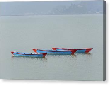 Three Blue Boats On Phewa Lake In Pokhara Canvas Print
