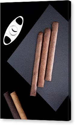 Canvas Print featuring the photograph Three Cigars On The Box And Cutter  by Andrey  Godyaykin