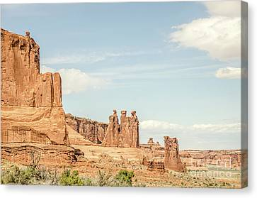 Canvas Print featuring the photograph Three Gossips And Sheep Rock by Sue Smith