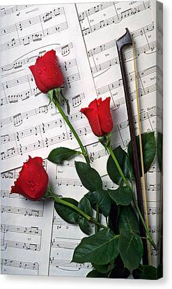 Three Red Roses  Canvas Print by Garry Gay