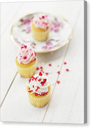 Canvas Print featuring the photograph Three Tiny Cupcakes by Rebecca Cozart