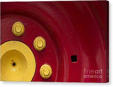 Three Yellow Nuts On A Red Wheel Canvas Print
