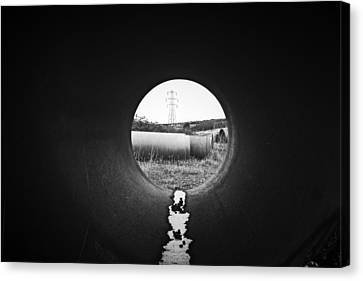 Through The Pipe Canvas Print by Keith Elliott