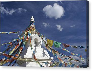 Tibetan Stupa With Prayer Flags Canvas Print by Michele Burgess
