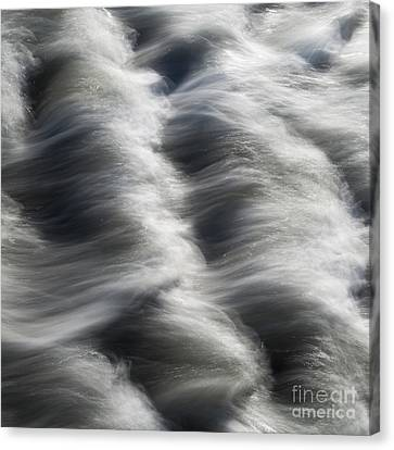 Tide Over Rocks Canvas Print by Tony Higginson