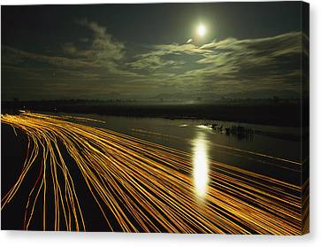 Time Lapse Of Lights From Boats Moving Canvas Print by Steve Winter