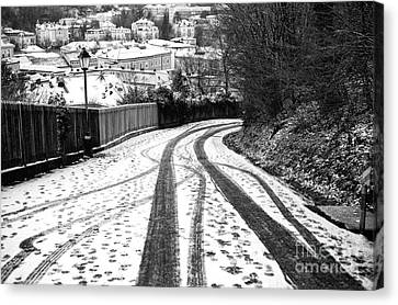 Tire Tracks In The Snow Canvas Print by John Rizzuto