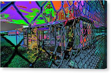 Tires And Broke Behind The Fence Canvas Print by Kenneth James