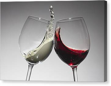 Red Wine Splash Canvas Print - Toasting With Glasses Of Water And Red Wine by Dual Dual