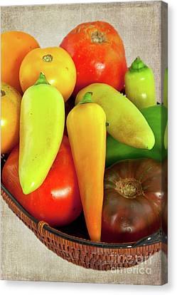 Canvas Print featuring the photograph Tomatoes Peppers In A Basket by Dan Carmichael