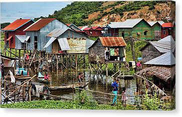 Tonle Sap Boat Village Cambodia Canvas Print by Chuck Kuhn
